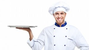 male chef holding silver platter