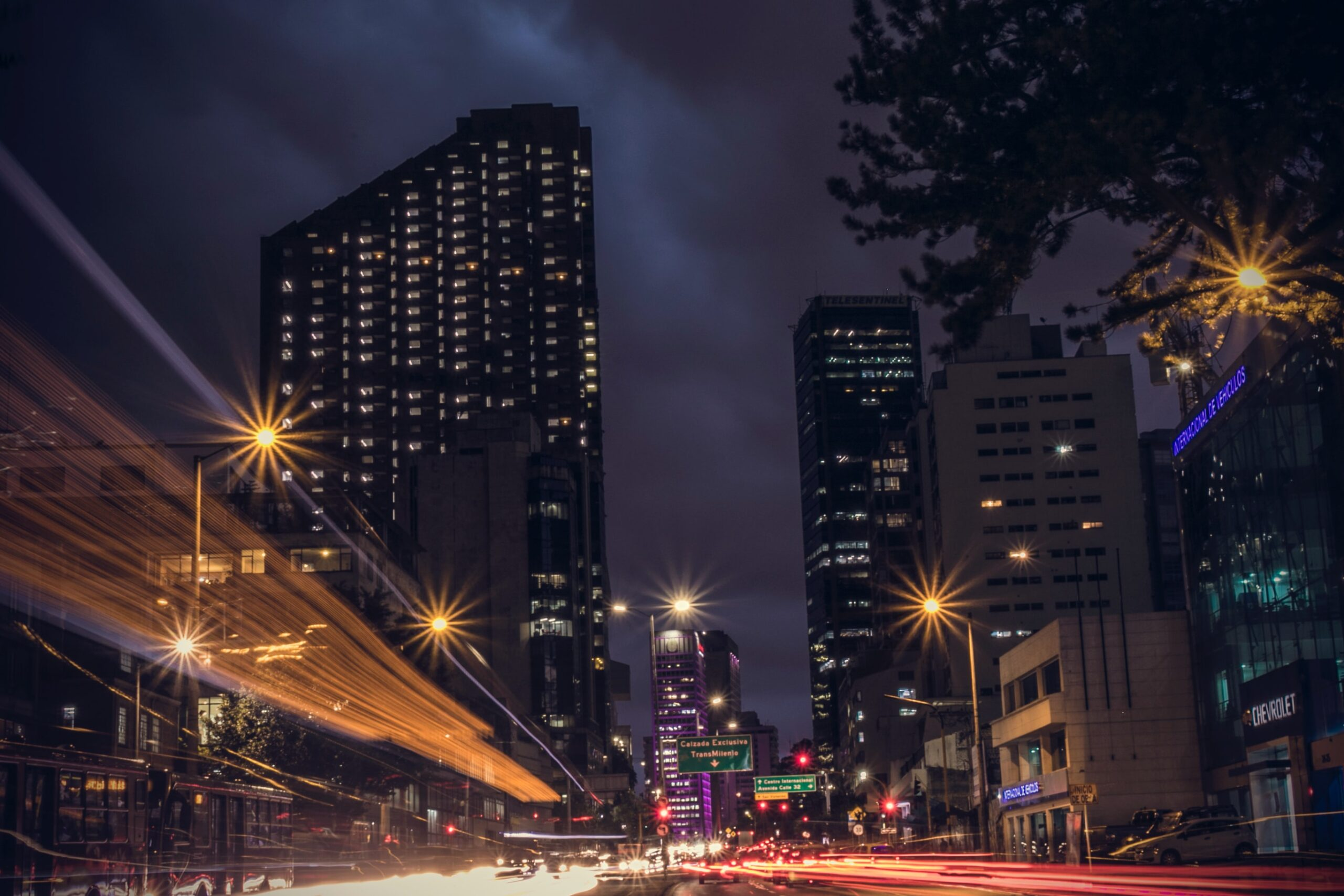 Welcome to Part 10 of theFirm of Her Own Series, which highlights the career of AMI SIX member Paula Echeverri Montes. Image of Bogota, Colombia city and lights. Photo by AltaGamba @altagamba on Unsplash.
